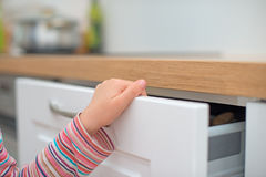 Child traps finger in the door. Dangerous situation at home. Child traps finger in the door Royalty Free Stock Images