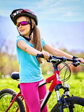 Child traveling bicycle in summer park. Stock Photo