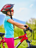 Child traveling bicycle in summer park. Royalty Free Stock Image