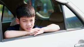 Child Traveling by Car, Asian boy Looking out of Window During stop, Trip in city.  stock video