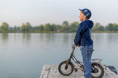 Child traveling on the river Royalty Free Stock Photo