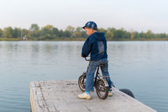 Child traveling on the river Stock Photography
