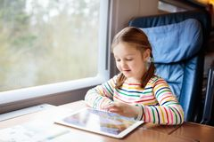 Kids travel by train. Railway trip with child. Child traveling by train. Little kid in a high speed express train on family vacation in Europe. Travel by royalty free stock images