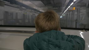 Child traveling in underground stock video footage