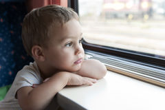 Child travelling by train Royalty Free Stock Images