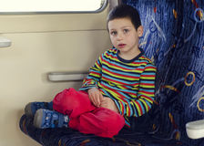 Child travelling on train Stock Photo