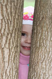 Child between the trees in autumn Stock Photography