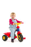 Child on tricycle Stock Photo