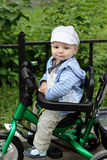 Child on tricycle in park Royalty Free Stock Image