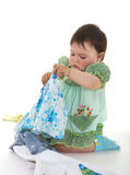 Child tries on clothes Stock Images