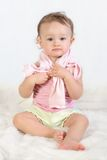 Child tries to dress oneself #2. Baby girl tries to dress oneself Stock Photos