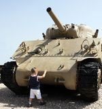 Child tries to stop tank Stock Images