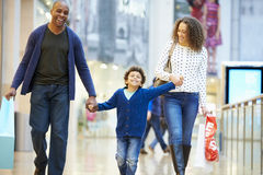 Child On Trip To Shopping Mall With Parents Stock Photos