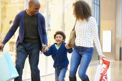 Child On Trip To Shopping Mall With Parents Stock Photography
