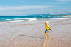 Child on tropical beach. Sea vacation with kids. Royalty Free Stock Photos