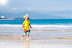 Child on tropical beach. Sea vacation with kids. Royalty Free Stock Photography
