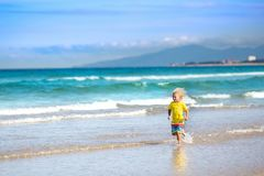 Child on tropical beach. Sea vacation with kids. Royalty Free Stock Images