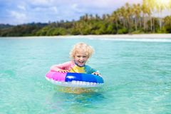 Child on tropical beach. Sea vacation with kids. Stock Photo