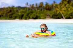 Child on tropical beach. Sea vacation with kids stock photos