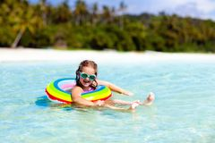 Child on tropical beach. Sea vacation with kids stock image