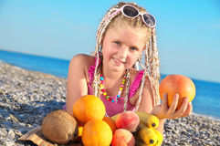 Child with tropical fruit Stock Photography
