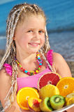 Child with tropical fruit Royalty Free Stock Image