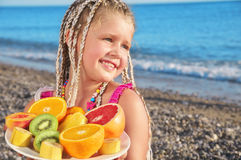 Child with tropical fruit Royalty Free Stock Photos