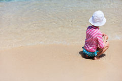 Child on a tropical vacation Stock Images