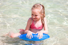 Child on a tropical vacation Stock Photo