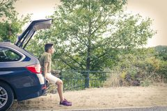 Child in the trunk of the car. Looking at the landscape Stock Photos