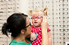 Child Trying On Eyeglasses Stock Photography