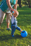 Child trying play in soccer or football. Royalty Free Stock Images