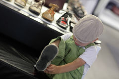 Child trying on shoes Royalty Free Stock Photos
