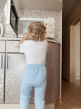 Child  trying to turn on  microwave Royalty Free Stock Photography