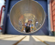 Child in a tube. Little boy in playground tube Stock Photos