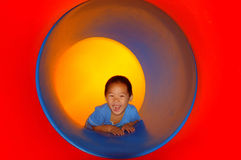 Child in tube slide Stock Photography