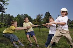 Child tug of war. Outdoors Stock Photo