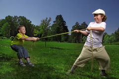 Child tug of war Stock Image