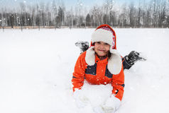 Child Tumbles in Snow Royalty Free Stock Photos