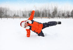 Child Tumbles in Snow Stock Images