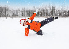 Child Tumbles in Snow Stock Photo