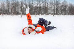 Child Tumbles in Snow Royalty Free Stock Photo