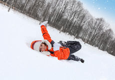Child Tumbles in Snow Stock Image