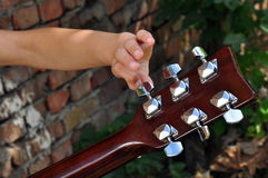 Child tuning  guitar Stock Photo