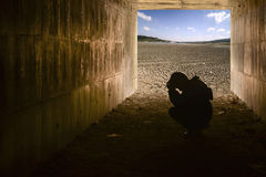 Child in tunnel and Cracked soil background with blue sky Royalty Free Stock Photos