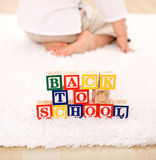 Child turning away from toy blocks Stock Photos