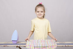 The child turns underwear when Ironing Royalty Free Stock Image