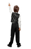 Child  in a tuxedo pointing at wall. Royalty Free Stock Photography