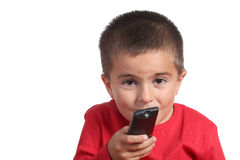 Child with tv remote control Royalty Free Stock Photo