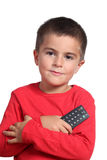 Child with tv remote control Stock Photo